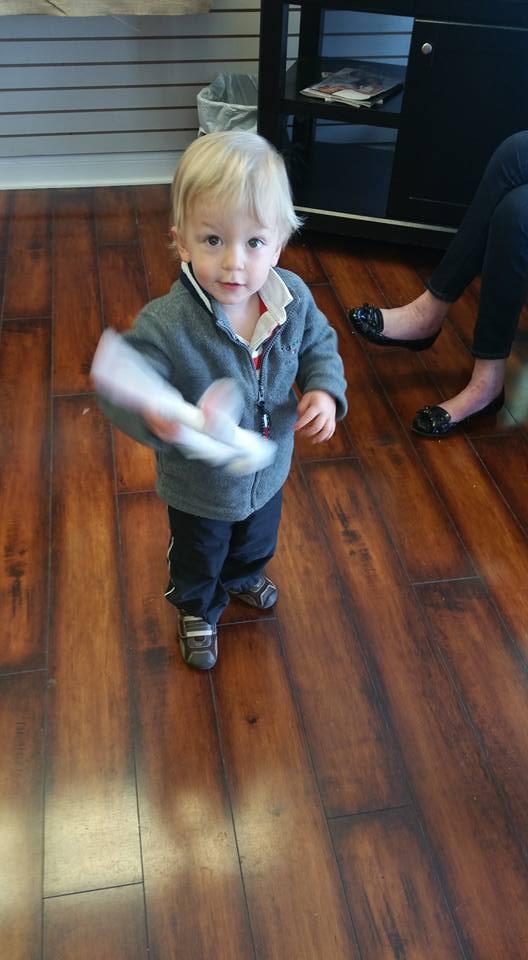Little Boy Holding Bunny Ears